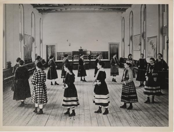 Calisthenics class exercising with Indian clubs, 1876 (Mount Holyoke College)
